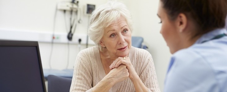 Nurse Discussing Test Results With Patient
